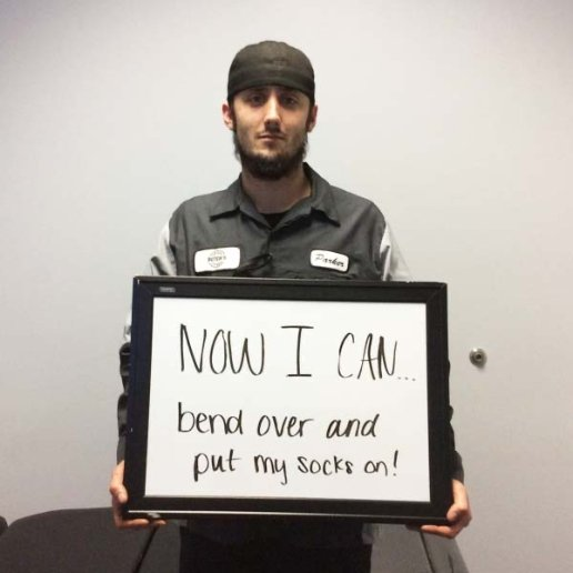 Person holding sign saying